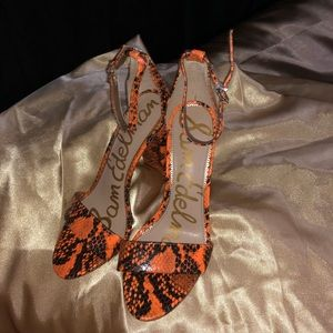 Orange and black snakeskin heels